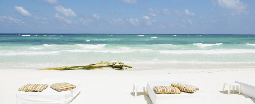 Beds on a white sand beach